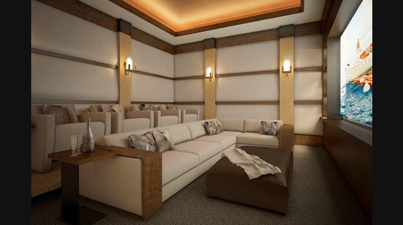 """En un departamento de lujo para un actor de cine como Leonardo diCaprio no podía faltar un salón para ver películas, hay un mueble delantero en forma de """"L"""", en la parte posterior hay cuatro cómodas butacas como en las mejores salas de cine"""