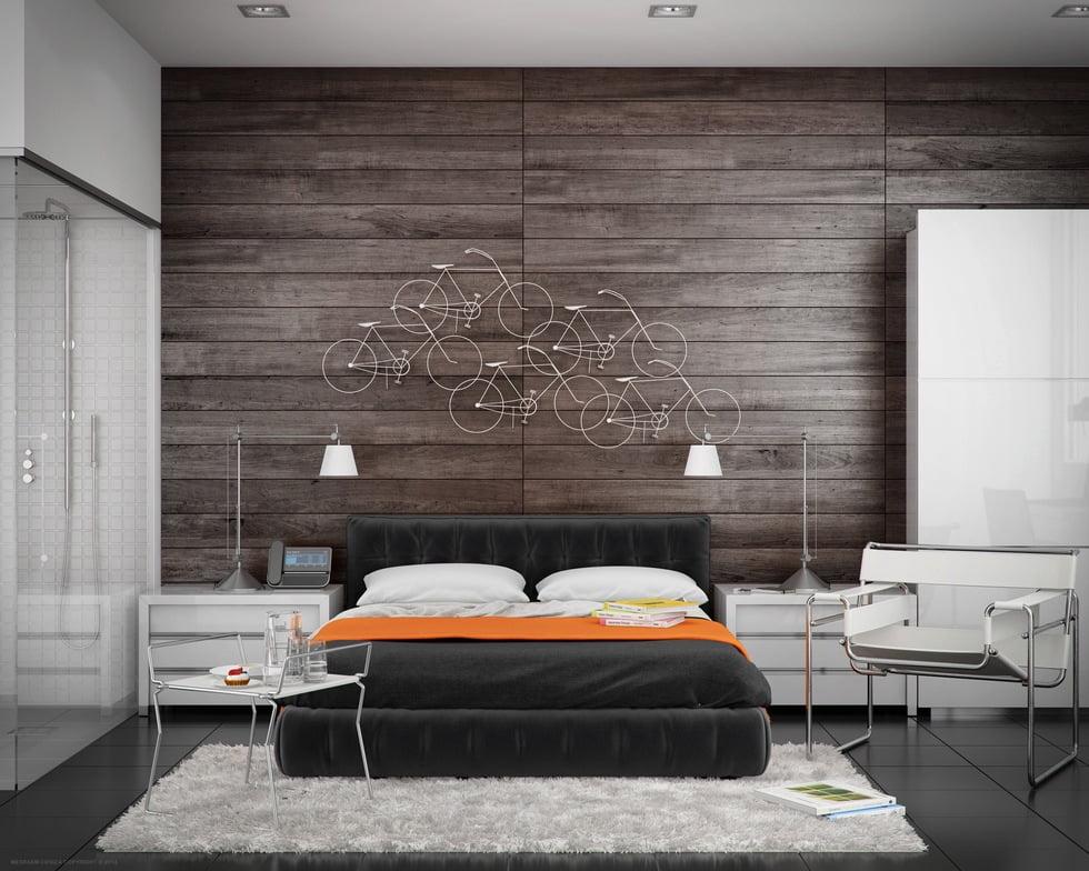 """Una pared con un enchapado de madera rústico es el """"lienzo"""" perfecto para colocar figuras decorativas de bicicletas, el piso de porcelanato negro combina con la tarima y el conjunto de la cama (Meraem Ceniza)"""
