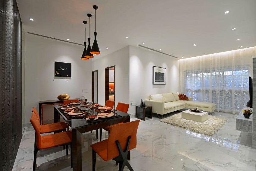 Vista del moderno diseño del comedor y al fondo la sala