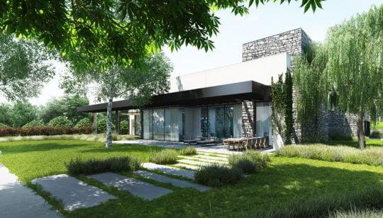 Fachada posterior de la casa, tiene un volado de techo pintado en negro que representa la cubierta para la terraza y comedor exterior