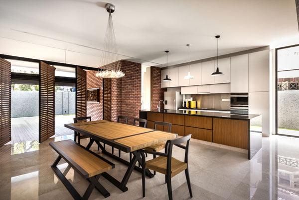Diseño de la cocina con isla – comedor de diario tienen acceso a terraza