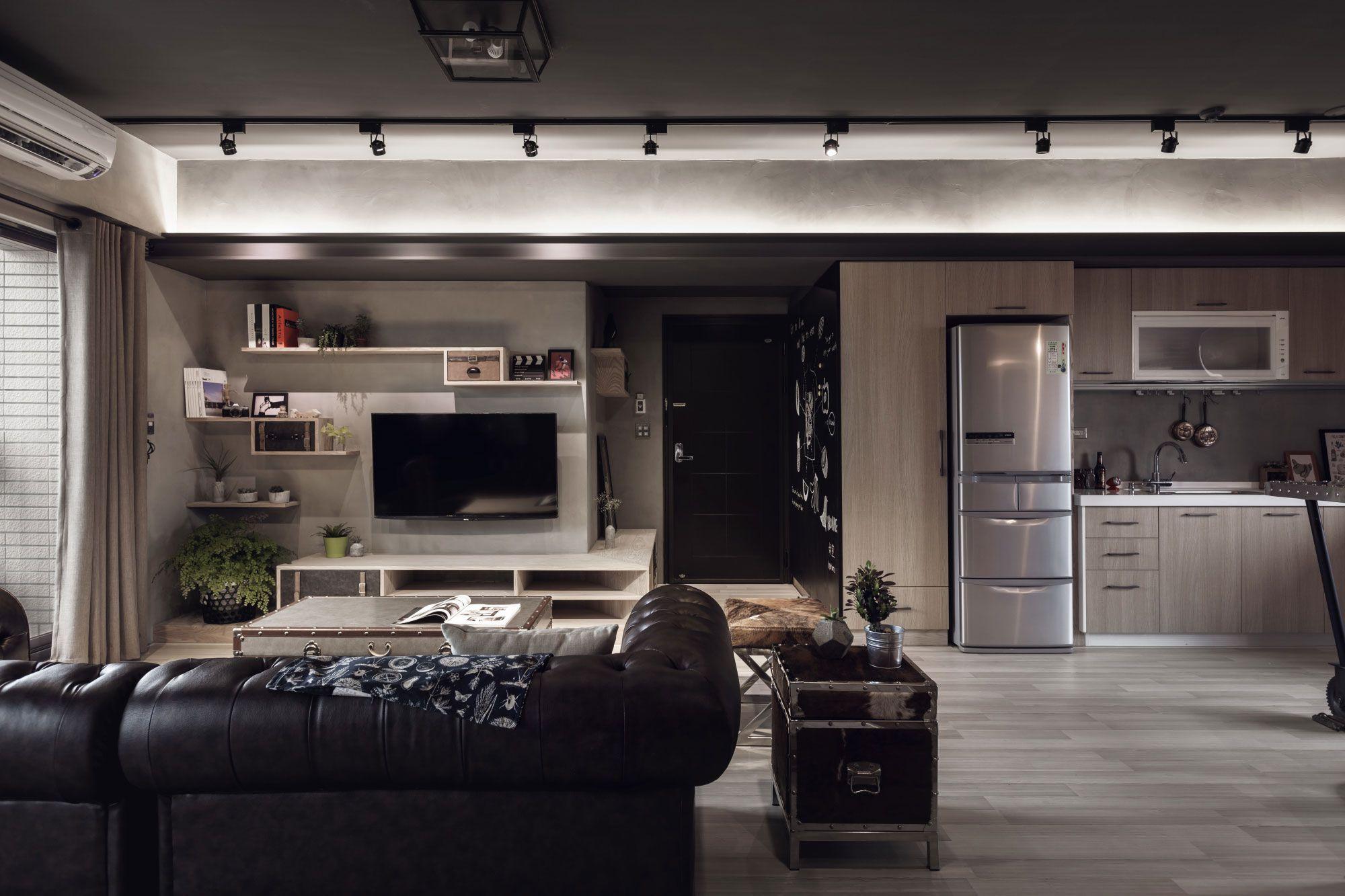 Diseño de la sala con paredes de concreto expuesto (Diseño: Hao Design Studio / Fotos: Hey! Cheese)
