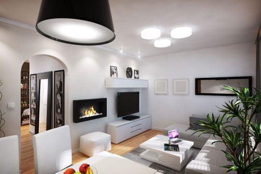 La decoración es minimalista con detalles que hacen resaltar el conjunto como la chimenea artificial