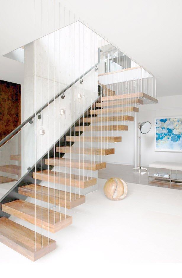 Diseño de escaleras de madera con tirantes de acero