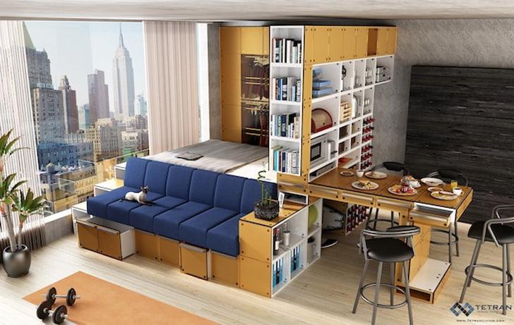 En un solo espacio tenemos la cama, el sofá y la cocina, gracias a un conjunto de estantes modulares (Tetran)