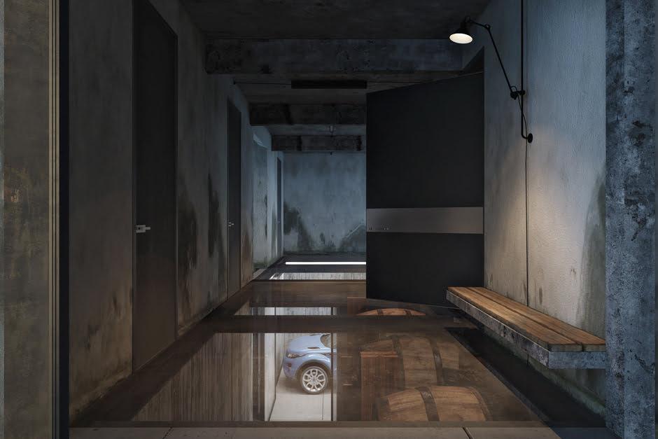 En este pasaje podemos ver el piso traslúcido con una gran puerta de madera, en el piso inferior podemos ver los barriles de la bodega y el estacionamiento