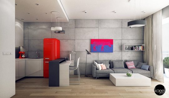 Mini apartamento luce amplio, se le han agregado detalles como una refrigeradora clásica en color rojo junto con un cuadro de arte pop a las paredes grises, si cambias tu mobiliario en la ampliación con las proporciones que muestra la imagen y eliminas algunas paredes o muros bajos puedes conseguir este hermoso diseño. (Kaeel Group)