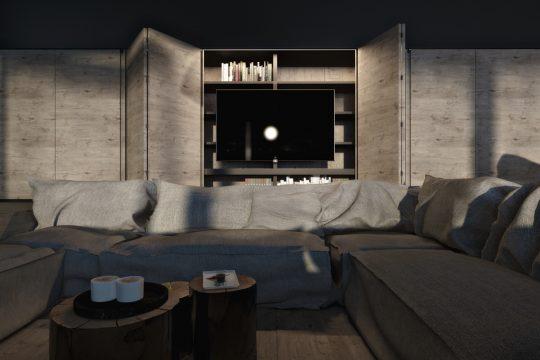 Un televisor que se esconde dentro de un armario, la mesa de centro la componen tres troncos de madera de distinto tamaño, los muebles llaman al relax