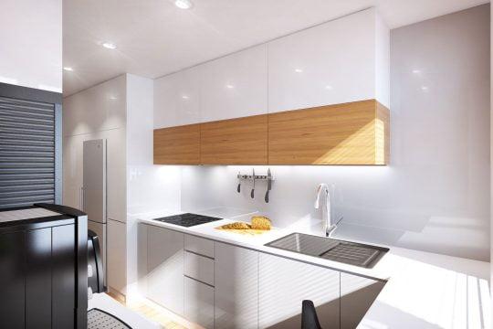 Vista correspondiente a la zona de la estufa y el lavatorio de cocina en color gris oscuro