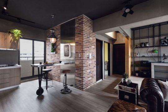 Buena combinación de paredes de ladrillo expuesto con el acero para la isla de cocina
