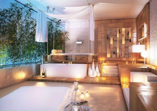 Un diseño perfecto si quieres crear un ambiente relajado en tu cuarto de baño,utiliza azulejos en tonos marrones claros e ilumínalos con puntos de luz cálida y las infaltables velas aromáticas