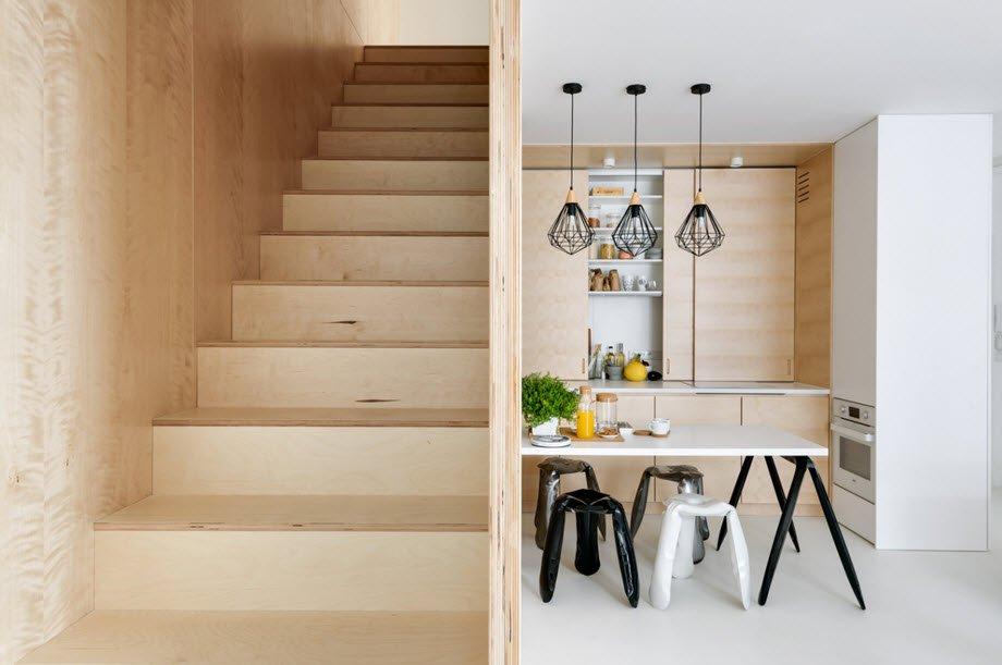 Lo simple y funcional destacan en el diseño de interiores de este pequeño departamento dúplex, tiene una paleta de colores donde predomina el color blanco aplicado a las paredes y techos junto con los pisos de resina.